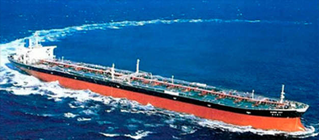 Old photo of large container ship in color.