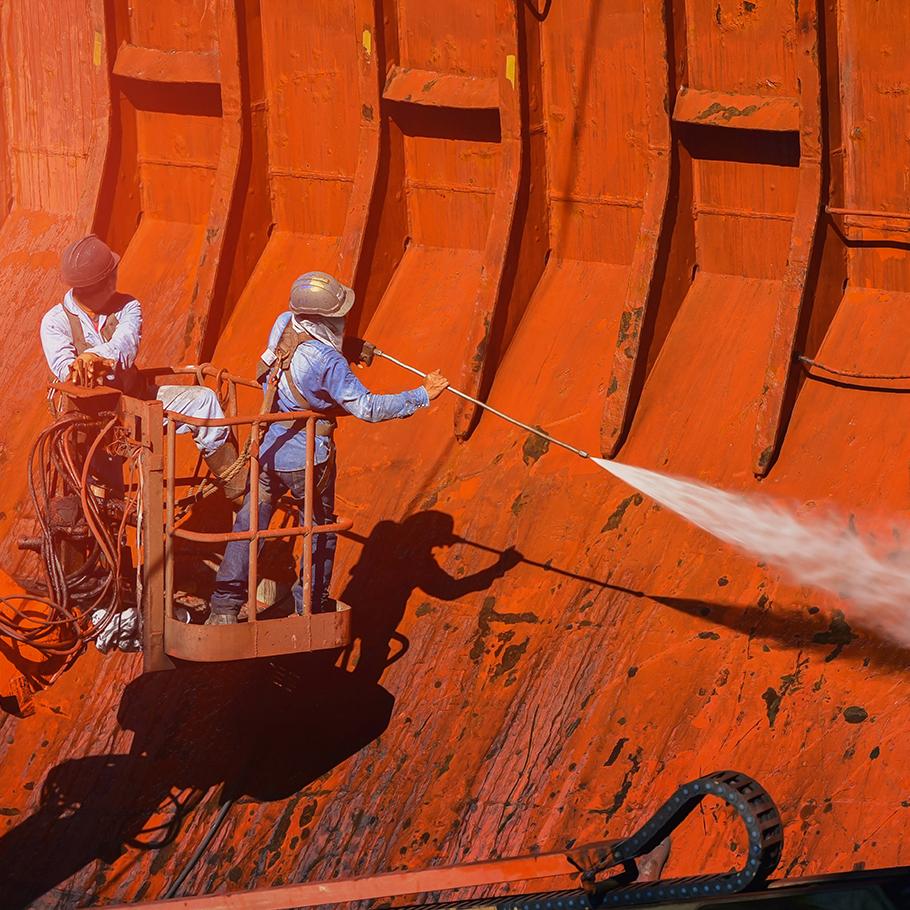 Large bulk ship carrying dark material.