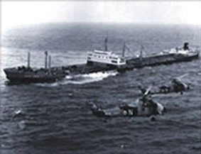 Old photo of a large container ship with military helicopters.