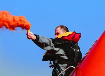 Man holding smoke signal