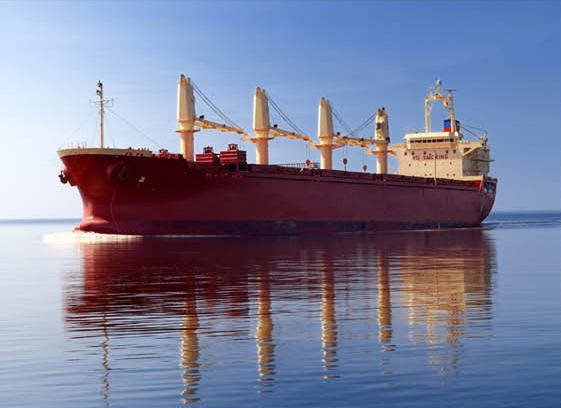 Red bulk carrier ship on the water.
