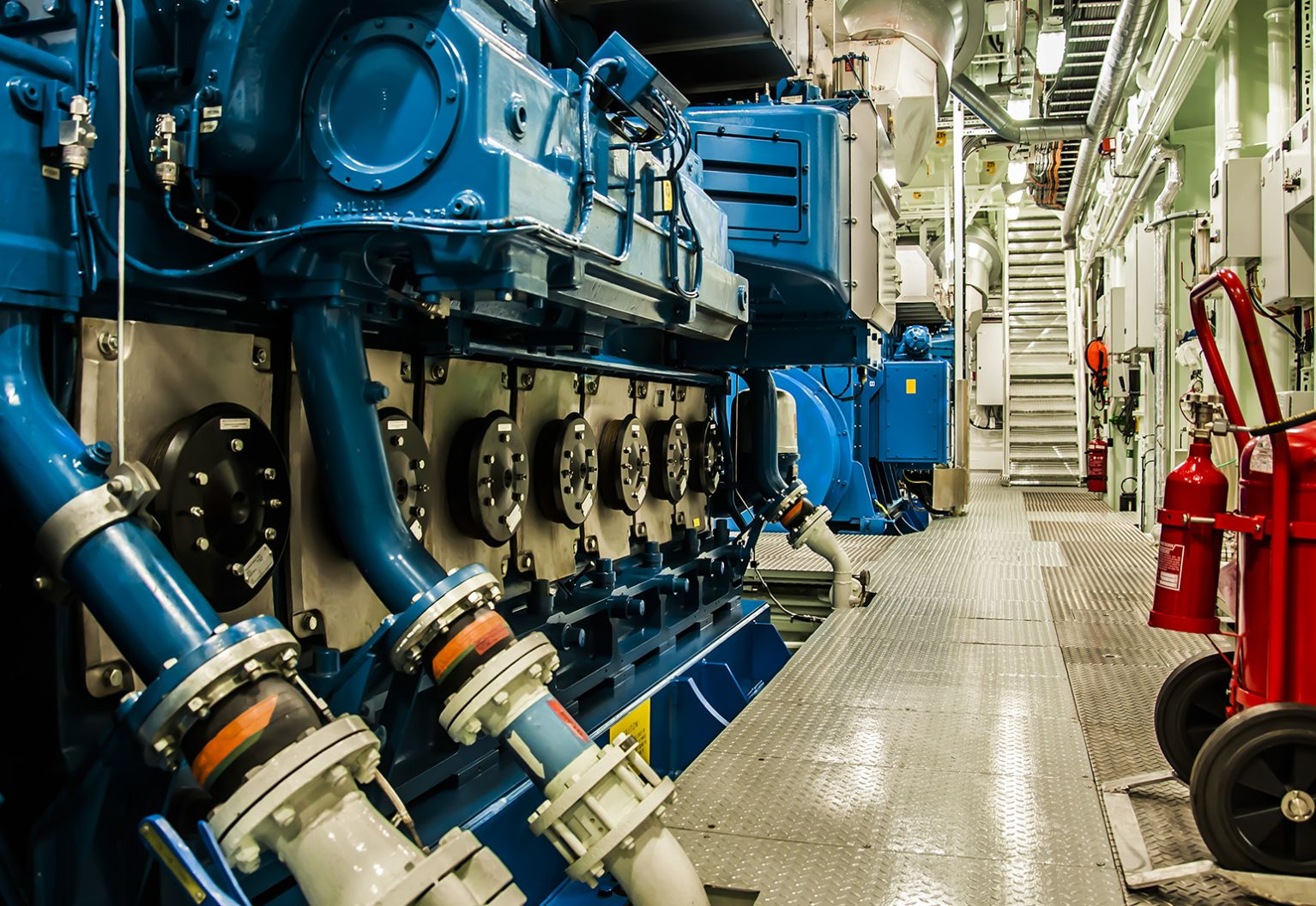 Internal engine room systems with blue piping.